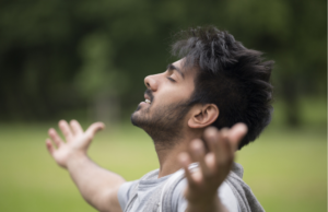 A Young Man Showing How to Control Your Emotions with Meditation